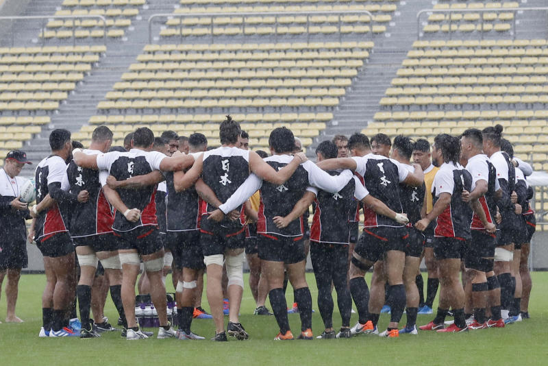 Japan team's players gather in circle during a training session, ahead of their Rugby World Cup Pool A match against Scotland as Typhoon Hagibis approaches Saturday, Oct. 12, 2019 in Tokyo. (Yuki Sato/Kyodo News via AP)