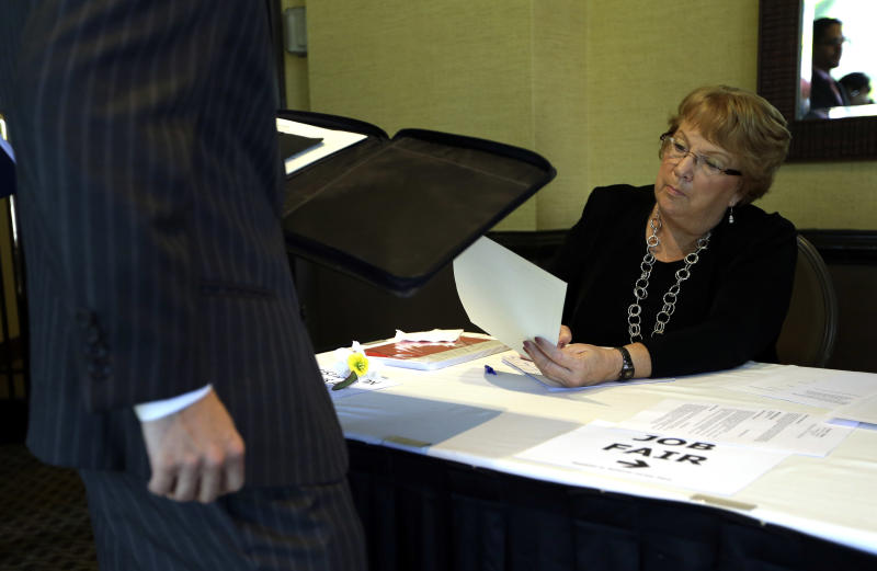 FILE-In this Sept. 17, 2012, file photo, Patti Maurer of Pompano Beach, Fla., right, registers a job seeker at a job fair held by National Career Fairs, in Fort Lauderdale, Fla. A private survey relased Wednesday, Oct. 3, 2012, shows that U.S. businesses hired fewer workers in September than August, a sign that slow growth may be holding back hiring.  Payroll processor ADP said Wednesday that companies added 162,000 jobs last month. That's below August's total of 189,000, which was revised lower.  (AP Photo/Lynne Sladky, File)