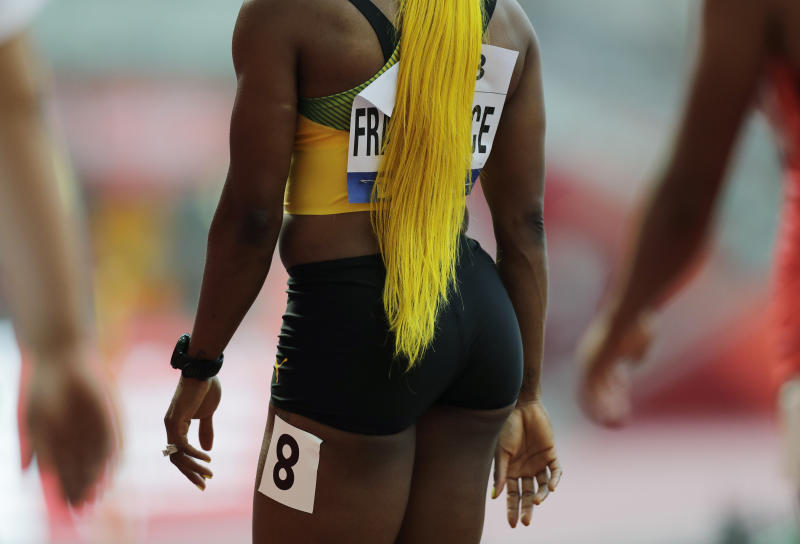 Shelly-Ann Fraser-Pryce, of Jamaica, finishes a the women's 100 meter heat at the World Athletics Championships in Doha, Qatar, Saturday, Sept. 28, 2019. (AP Photo/Petr David Josek)