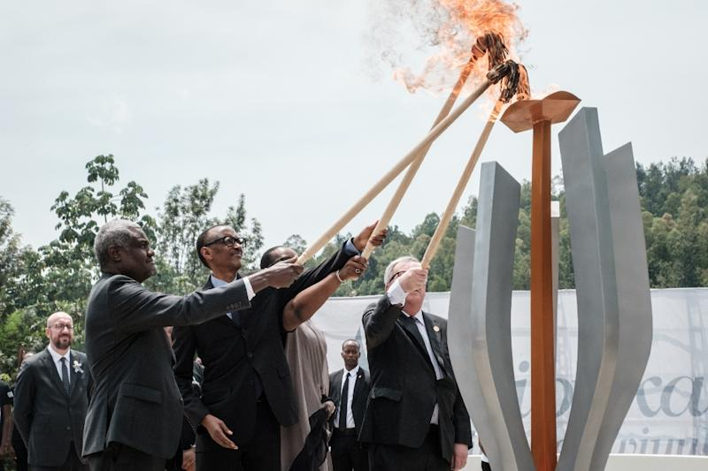 The Rwandan president, centre, lit the remembrance flame along with African Union chief Moussa Faki and Rwandan First Lady Jeannette Kagame (AFP Photo/Yasuyoshi CHIBA)