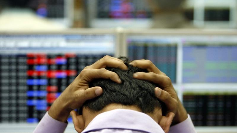 An Indian broker reacts while trading at a stock brokerage firm in Mumbai. Photo courtesy Reuters