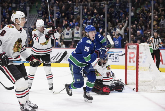Vancouver Canucks' Adam Gaudette (88) celebrates his goal against Chicago Blackhawks goalie Corey Crawford (50) during the second period of an NHL hockey game Wednesday, Feb. 12, 2020, in Vancouver, British Columbia. (Darryl Dyck/The Canadian Press via AP)