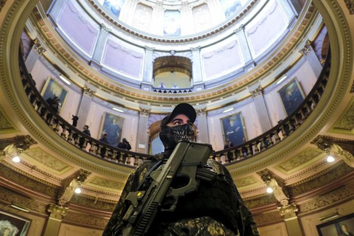 Armed protester wearing a mask in the Michigan Capitol building