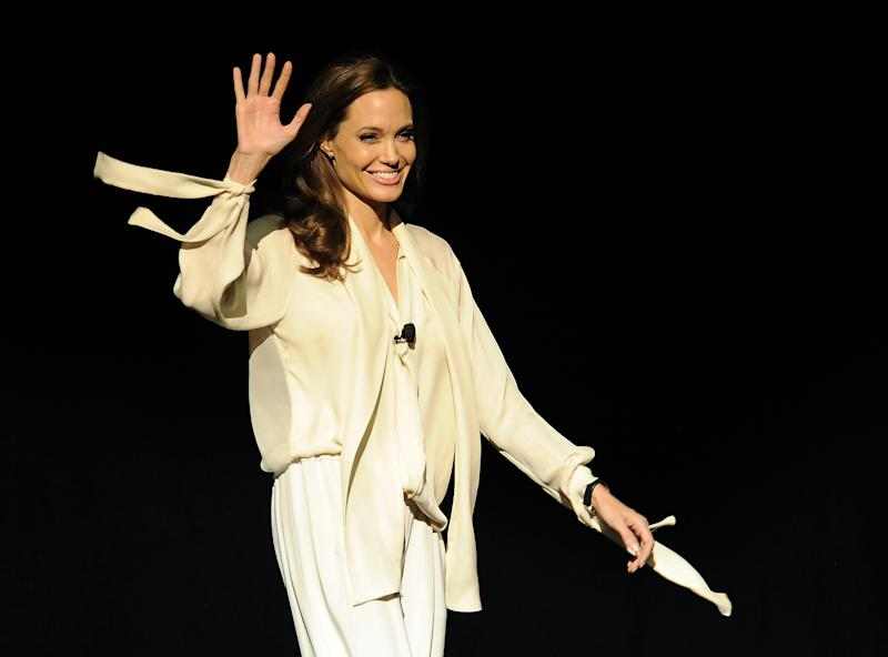 "Angelina Jolie, director of the upcoming film ""Unbroken,"" makes a surprise appearance onstage to introduce a trailer for the film during a Universal Pictures studio presentation at CinemaCon 2014 on Tuesday, March 25, 2014 in Las Vegas. (Photo by Chris Pizzello/Invision/AP)"
