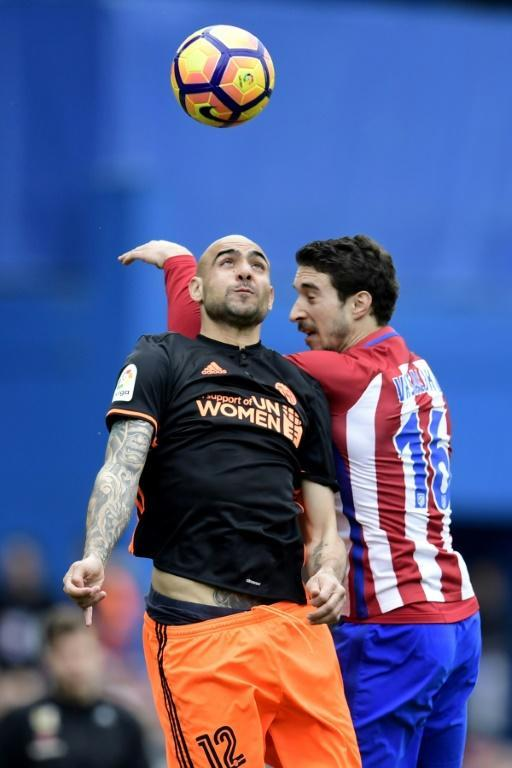 Valencia's forward Simone Zaza (L) vies with Atletico Madrid's Croatian defender Sime Vrsaljko during the Spanish league football match Club Atletico de Madrid vs Valencia CF at the Vicente Calderon stadium in Madrid on March 5, 2017
