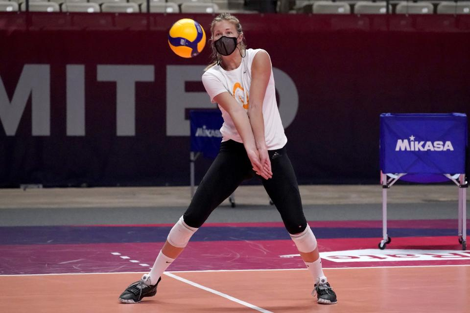 Karsta Lowe reaches out to make a pass during volleyball practice in Dallas, Wednesday, Feb. 24, 2021. U.S. Olympian Lowe is playing competitive volleyball again for the first time since the pandemic had her scrambling to get home from a pro league in Italy a year ago. (AP Photo/Tony Gutierrez)
