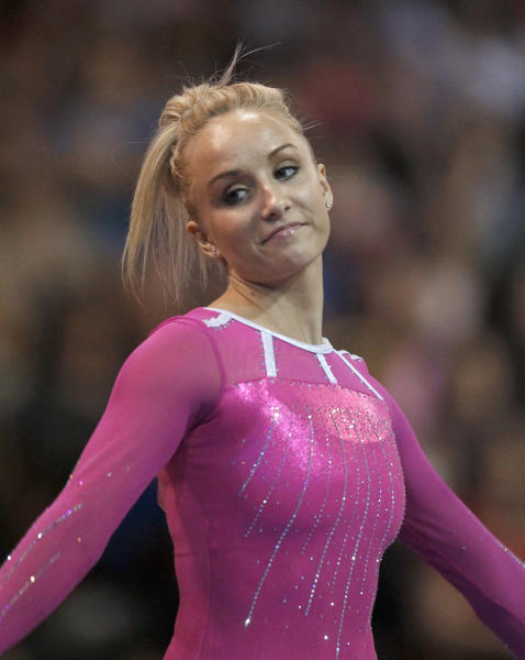 Nastia Liukin reacts after scratching from the uneven bars, at the U.S. Classic gymnastics meet Saturday, May 26, 2012, in Chicago. Olympic champion Liukin tied for third on balance beam in her first competition in three years. (AP Photo/Charles Rex Arbogast)