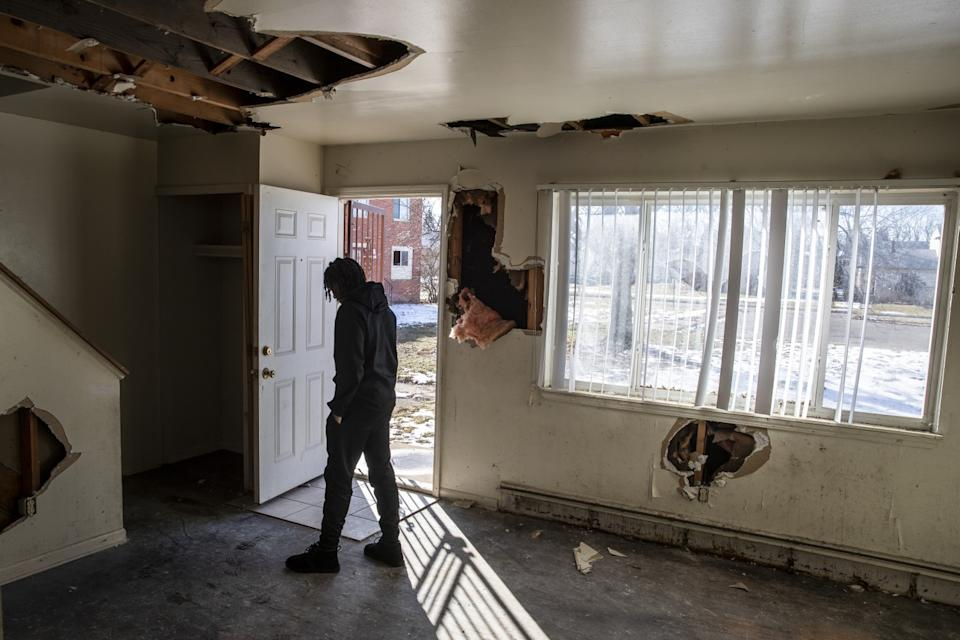 Flint basketball player Onquay Clemons walks into the abandoned, dilapidated remains of his boyhood home.
