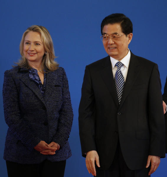 U.S. Secretary of State Hillary Rodham Clinton, left, stands with Chinese President Hu Jintao during the opening ceremony of the U.S.- China Strategic and Economic Dialogue at the Diaoyutai state guesthouse in Beijing Thursday, May 3, 2012. (AP Photo/Vincent Thian)