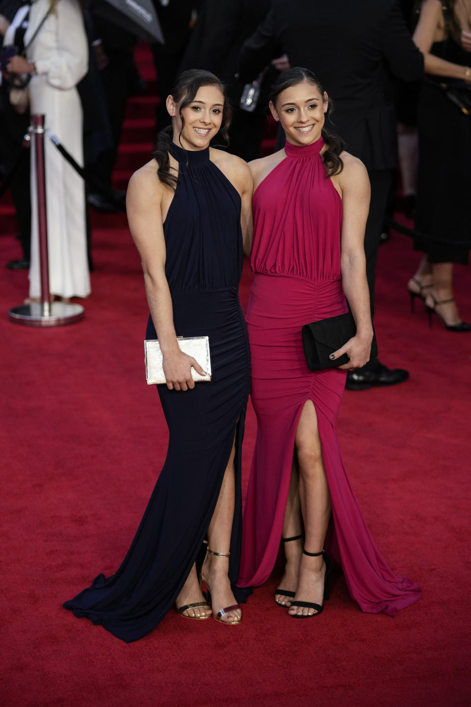 Jennifer Gadirova and Jessica Gadirova pose for photographers upon arrival for the World premiere of the new film from the James Bond franchise 'No Time To Die', in London Tuesday, Sept. 28, 2021. (AP Photo/Matt Dunham)