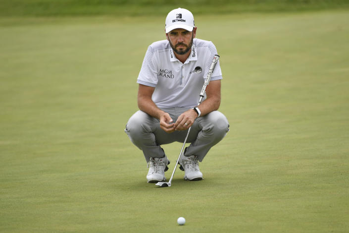 Troy Merritt lines up a shot on the 18th hole during the first round of the 3M Open golf tournament in Blaine, Minn., Thursday, July 22, 2021. (AP Photo/Craig Lassig)
