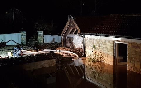 Property in Dunkerton, Somerset, flooded after Storm Brendan hits the West Country - Credit: Avon Fire & Rescue