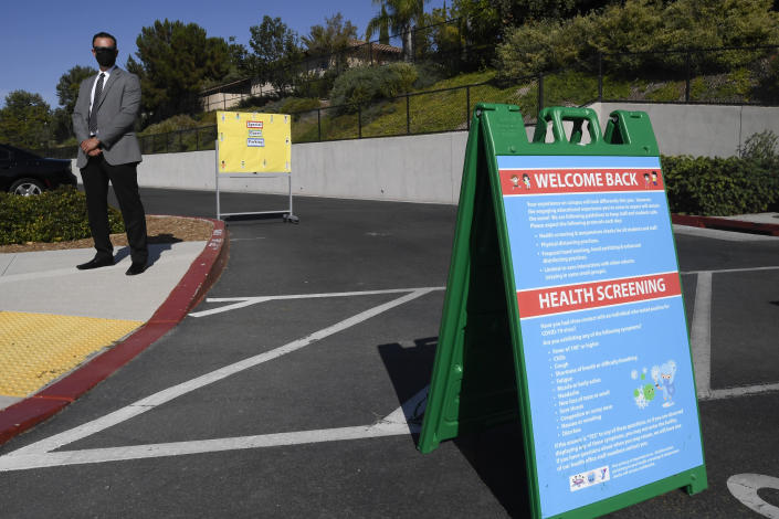 A sign posted with health standards sits outside of Enrique S. Camarena Elementary School, Wednesday, July 21, 2021, in Chula Vista, Calif. The school is among the first in the state to start the 2021-22 school year with full-day, in-person learning. (AP Photo/Denis Poroy)