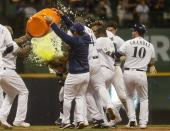 Milwaukee Brewers' Ben Gamel is dunked after hitting a walk-off single during the ninth inning of a baseball game against the San Francisco Giants Saturday, July 13, 2019, in Milwaukee. The Brewers won 5-4. (AP Photo/Morry Gash)