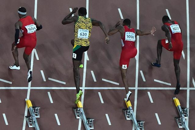 """(r-l) USA's Justin Gatlin, USA's Tyson Gay, Jamaica's Usain Bolt, USA's Mike Rodgers, USA's Trayvon Bromell prepare to compete in the final of the men's 100 metres athletics event at the 2015 IAAF World Championships at the """"Bird's Nest"""" National Stadium in Beijing on August 23, 2015. AFP PHOTO / ANTONIN THUILLIER (AFP Photo/Antonin Thuillier)"""