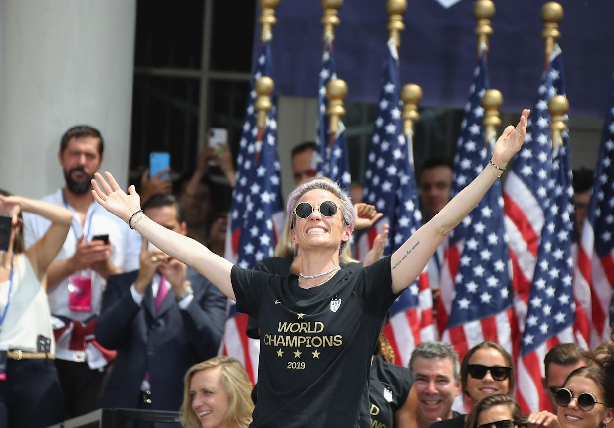 """NEW YORK, NEW YORK - JULY 10: Megan Rapinoe and members of the United States Women's National Soccer Team are honored at a ceremony at City Hall on July 10, 2019 in New York City. The honor followed a ticker tape parade up lower Manhattan's """"Canyon of Heroes"""" to celebrate their gold medal victory in the 2019 Women's World Cup in France. (Photo by Bruce Bennett/Getty Images)"""