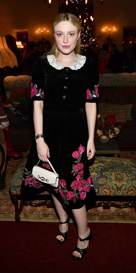 <p>Dakota Fanning attended a party in a floral Gucci dress with black sandals and a white handbag.</p>