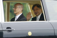 Emperor Naruhito waves as he leaves the Imperial Palace after the enthronement ceremony, Tuesday, Oct. 22, 2019, in Tokyo, Japan. (AP Photo/Eugene Hoshiko)