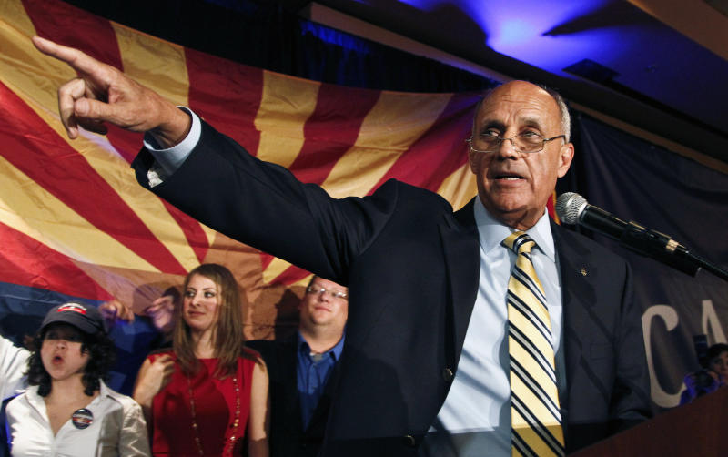 FILE - In this Tuesday, Nov. 6, 2012 file photo, Democratic Senate candidate Richard Carmona gives his concession to Republican Rep. Jeff Flake at a Democratic Party gathering, in Tucson, Ariz., as the two were running for the Senate seat vacated by retiring Republican Jon Kyl. Former U.S. Surgeon General Carmona, who highlighted the dangers of secondhand smoke and supported a ban on all tobacco products, is joining the board of directors for NJOY Inc., the nation's leading electronic cigarette company — a move that could bring increased legitimacy to e-cigarettes as a viable alternative to traditional cigarettes. (AP Photo/Ross D. Franklin, File)