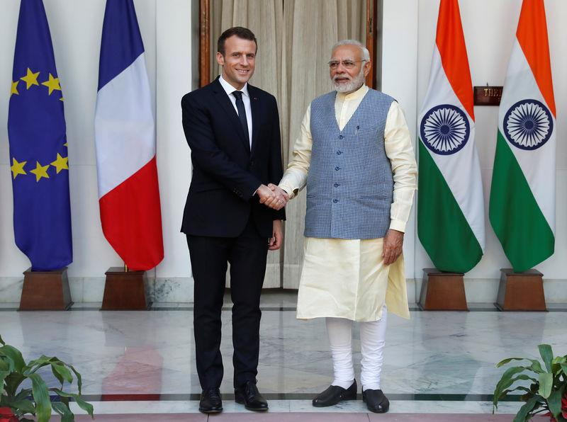 French President Macron shakes hands with India's PM Modi during a photo opportunity ahead of their meeting at Hyderabad House in New Delhi