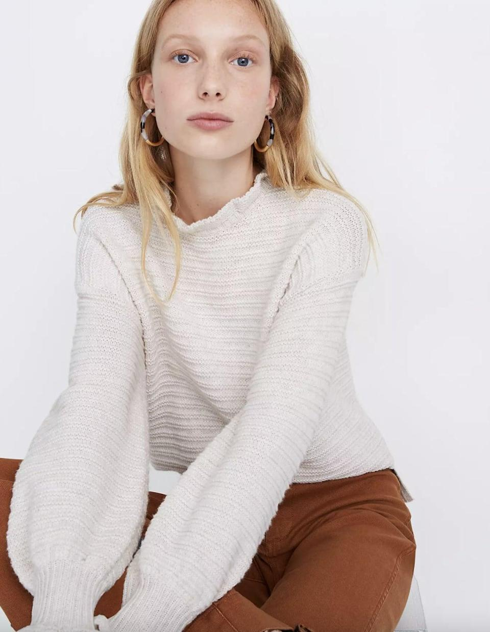 <p>This <span>Madewell Ruffle-Neck Pullover Sweater</span> ($50, originally $88) looks delicate and cute.</p>