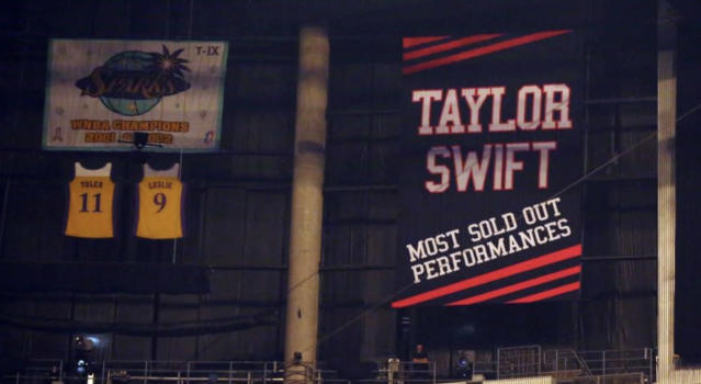 Taylor Swift's banner inside Staples Center that is allegedly cursed, as seen in 2015. (Matt Sayles / Associated Press)