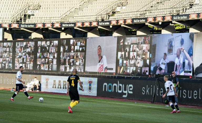 Fans were streamed live on to the screens during the match between AGF and Randers (AFP Photo/Henning Bagger)