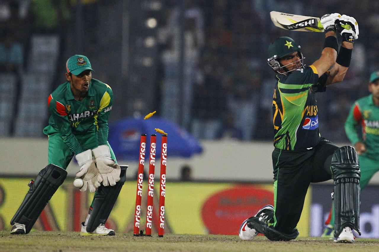 Pakistan's captain Misbah-ul-Haq is bowled out by Bangladesh's Shakib Al Hasan during their match in the Asia Cup one-day international cricket tournament in Dhaka, Bangladesh, Tuesday, March 4, 2014. (AP Photo/A.M. Ahad)
