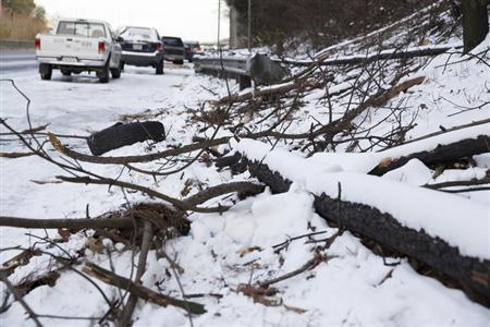 Cars are parked on Interstate 285 after being stranded overnight in Atlanta, Georgia