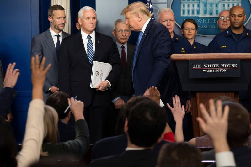 Reporters ask questions as US President Donald Trump departs after speaking during a press briefing about the Coronavirus (COVID-19) alongside US Vice President Mike Pence and members of the Coronavirus Task Force in the Brady Press Briefing Room at the White House in Washington, DC, March 15, 2020. (Jim Watson/AFP via Getty Images)