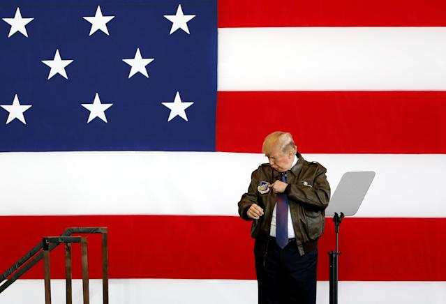 President Donald Trump points to a detail on his flight jacket while on stage at a U.S. Air Force base  on the outskirts of Tokyo, Japan, on Nov. 5, 2017. (Toru Hanai/Reuters)
