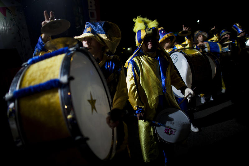 """Drummers of the murga """"Los amantes de La Boca"""" perform during carnival celebrations in Buenos Aires, Argentina, Saturday, Feb. 2, 2013. Argentina's carnival celebrations may not be as well-known as the ones in neighboring Uruguay and Brazil, but residents of the nation's capital are equally passionate about their """"murgas,"""" or traditional musical troupes. The murga """"Los amantes de La Boca,"""" or """"The Lovers of The Boca"""" is among the largest, with about 400 members. It's a reference to the hometown Boca Juniors, among the most popular soccer teams in Argentina and the world. (AP Photo/Natacha Pisarenko)"""
