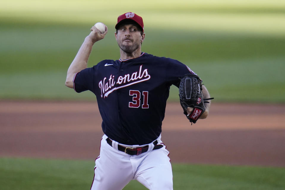 Washington Nationals starting pitcher Max Scherzer throws a pitch to the Los Angeles Dodgers during the first inning of a baseball game, Friday, July 2, 2021, in Washington. (AP Photo/Julio Cortez)