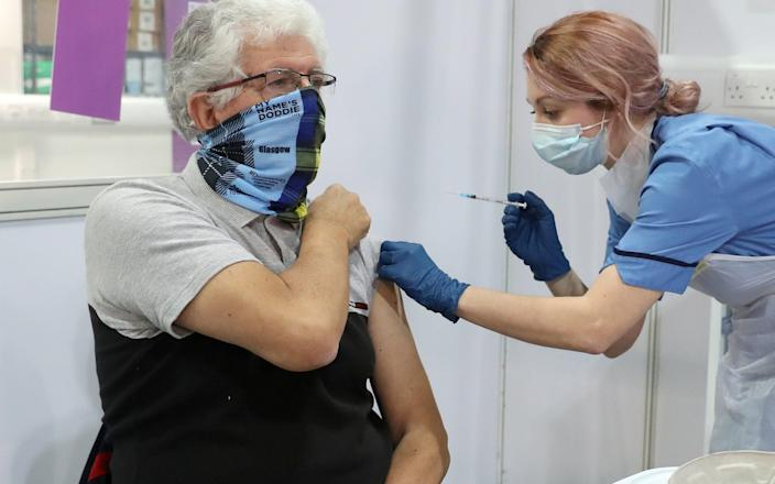 69-year-old John Loch from Glasgow receives his first dose of the vaccine from nurse Nicole Clark at the NHS Louisa Jordan Hospital on February 10, 2021 in Glasgow, Scotland. - Getty Images