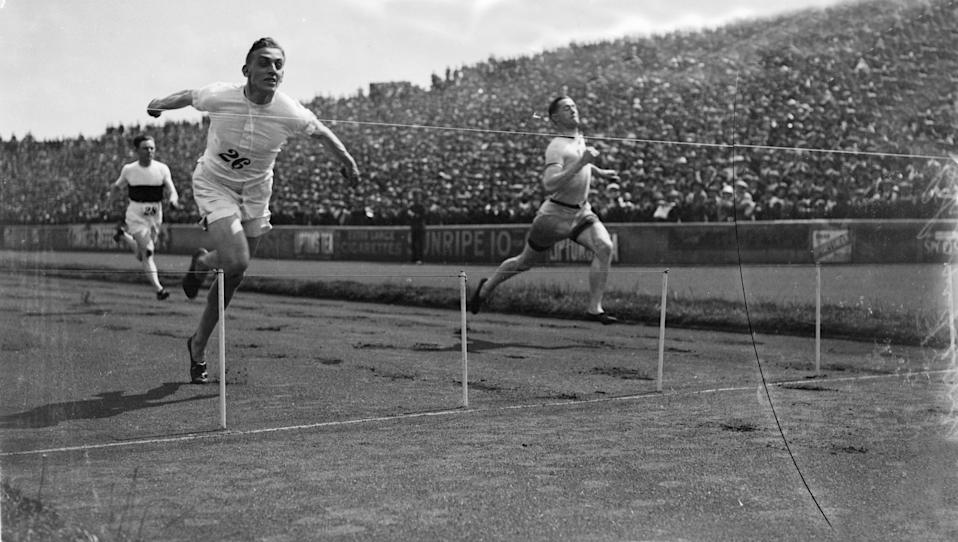 1924:  British sprinter Harold Abrahams crosses the finish line to win the 100 yards race at the AAA Championships. Harold Abrahams (1899 - 1978) the 1924 Paris Olympic 100 metres champion whose feat was later immortalised in the film Chariots of Fire (1981).  (Photo by Central Press/Getty Images)