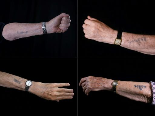 Holocaust survivors show Auschwitz prison numbers on their arms