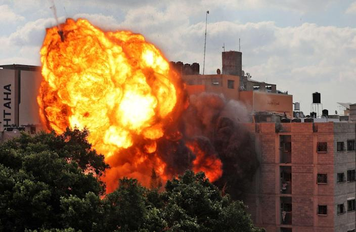 A ball of fire engulfs the Walid building in Gaza City.