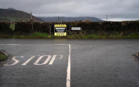 A road sign warning of possible road closures on the border road near Crossmaglen - Credit: Geoff Pugh / Telegraph