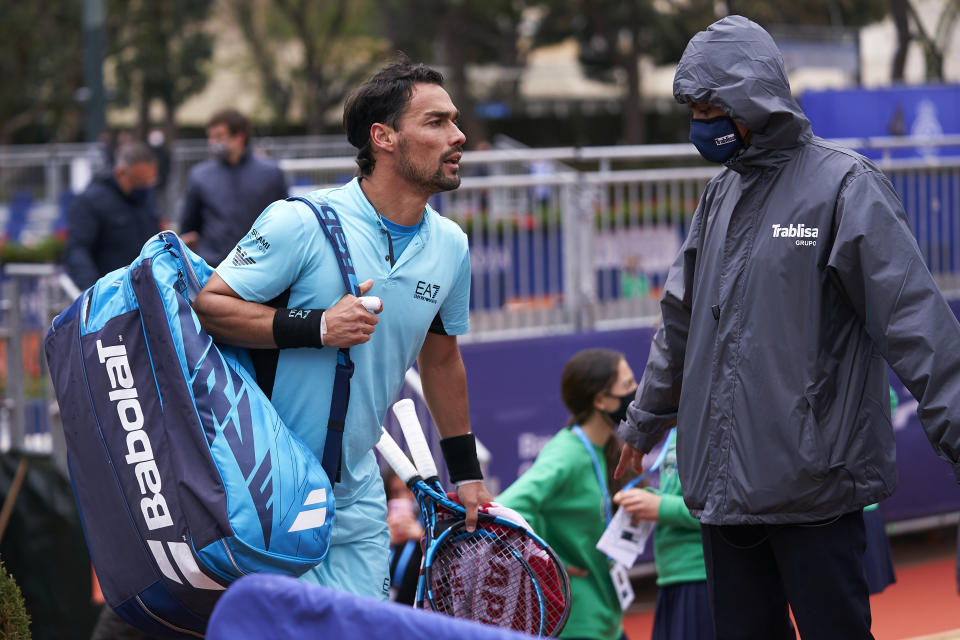 Fabio Fognini (pictured left) argues with the judge during after being defaulted at the Barcelona Open.