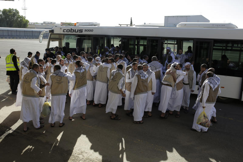 Yemeni prisoners gather during their arrival after being released by the Saudi-led coalition in the airport of Sanaa, Yemen, Thursday, Nov. 28, 2019. The International Committee of the Red Cross says over a hundred rebel prisoners released by the Saudi-led coalition have returned to Houthi-controlled territory in Yemen, a step toward a long-anticipated prisoner swap between the warring parties. (AP Photo/Hani Mohammed)
