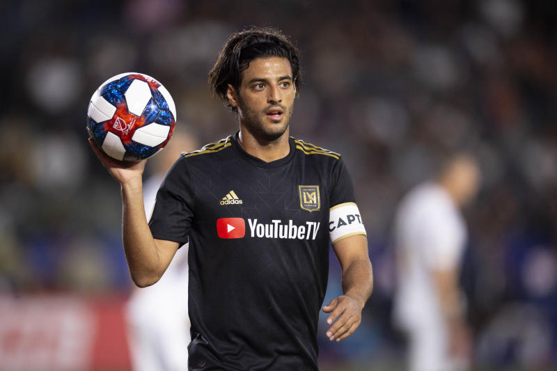 Jul 19, 2019; Carson, CA, USA; Los Angeles FC forward Carlos Vela (10) heads to a corner kick during the first half against the LA Galaxy at Dignity Health Sports Park. Mandatory Credit: Kelvin Kuo-USA TODAY Sports