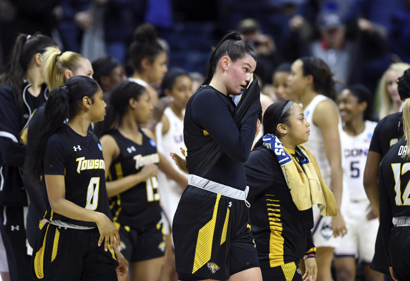 Towson's Tess Borgosz, center, reacts as she and teammates leave the court after losing to Connecticut during a first round women's college basketball game in the NCAA Tournament, Friday, March 22, 2019, in Storrs, Conn. (AP Photo/Stephen Dunn)