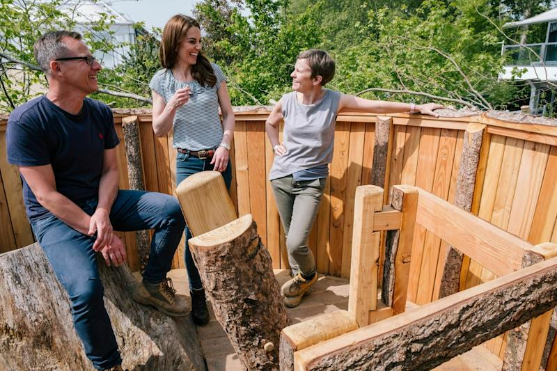 The Duchess of Cambridge talks to Adam White, left and Andree Davies in their co-designed 'Back to Nature' garden (AP)