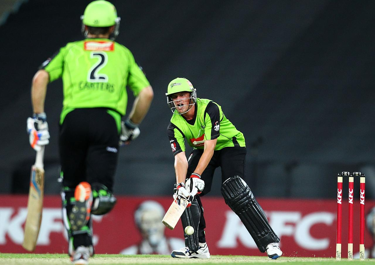 SYDNEY, AUSTRALIA - DECEMBER 14:  Chris Tremain of the Thunder bats during the Big Bash League match between the Sydney Thunder and the Melbourne Renegades at ANZ Stadium on December 14, 2012 in Sydney, Australia.  (Photo by Mark Nolan/Getty Images)