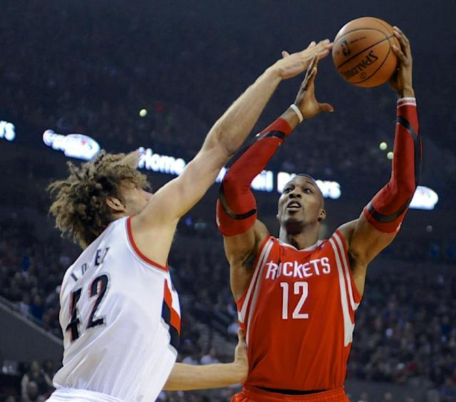 Houston Rockets' Dwight Howard (12) shoots against Portland Trail Blazers' Robin Lopez (42) during the first half of game four of an NBA basketball first-round playoff series game in Portland, Ore., Sunday March 30, 2014. (AP Photo/Greg Wahl-Stephens)