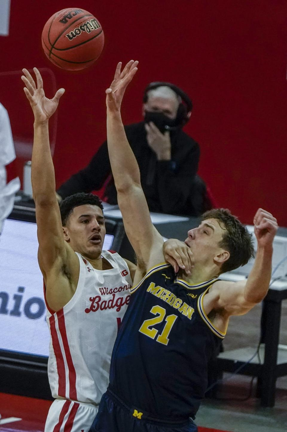 Wisconsin's Jonathan Davis shoots over Michigan's Franz Wagner during the second half of an NCAA college basketball game Sunday, Feb. 14, 2021, in Madison, Wis. (AP Photo/Morry Gash)