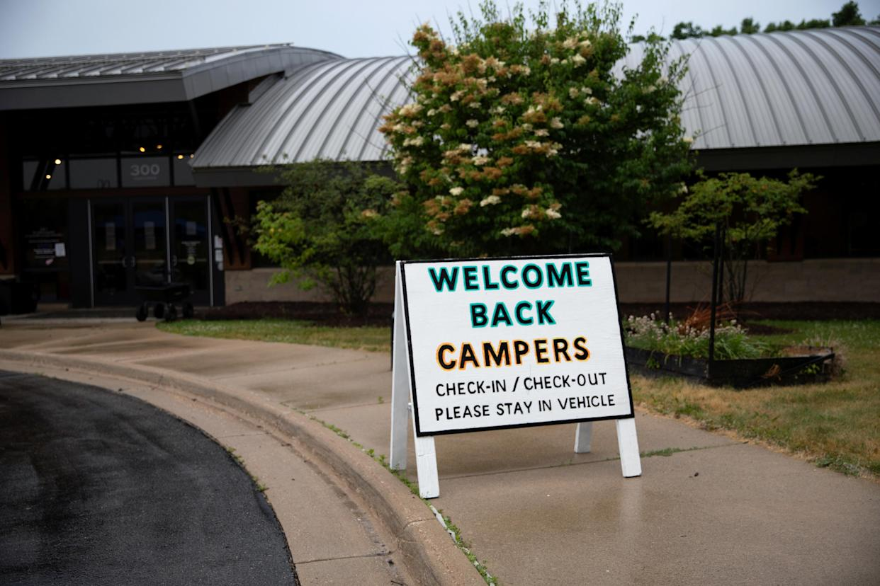 Children arrive for check-in amid the coronavirus disease (COVID-19) at Carls Family YMCA summer camp in Milford, Michigan, U.S., June 23, 2020.  REUTERS/Emily Elconin