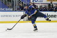 St. Louis Blues' Justin Faulk shoots during the second period of an NHL hockey game against the San Jose Sharks Monday, Jan. 18, 2021, in St. Louis. (AP Photo/Jeff Roberson)
