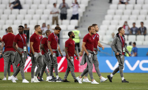 Team England inspects the pitch prior the group G match between Tunisia and England at the 2018 soccer World Cup in the Volgograd Arena in Volgograd, Russia, Monday, June 18, 2018. (AP Photo/Frank Augstein)