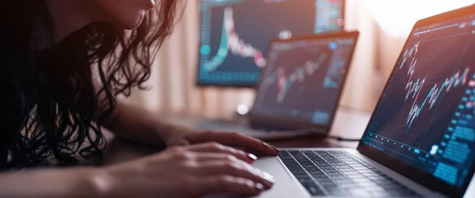 Woman looks at stock markets on the computer
